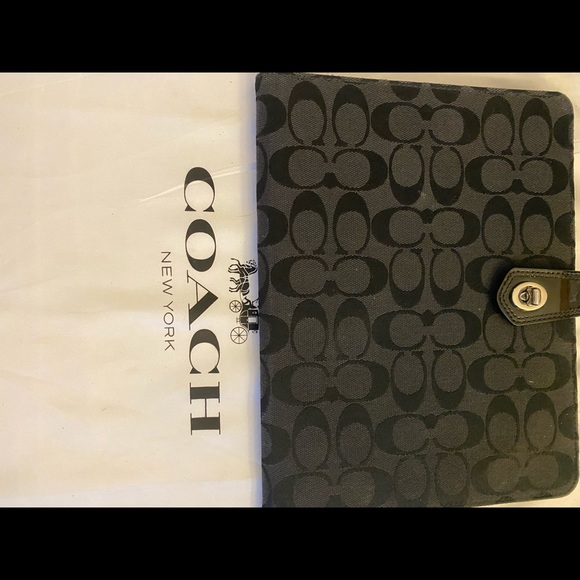 Genuine Coach IPad Cover with signature C fabric and patent leather details.